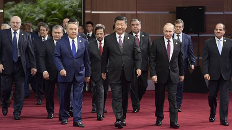Chinese President Xi Jinping (front center) walks with Russian President Vladimir Putin (front second from right) and other world leaders on Friday to attend the opening ceremony of the Second Belt and Road Forum for International Cooperation in Beijing. Photo: Xinhua