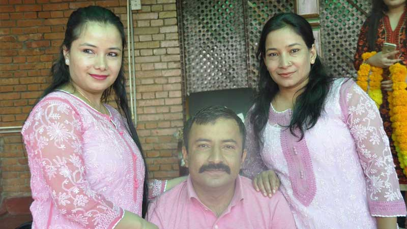 Prakash Dahal with his sisters Renu Dahal and Ganga Dahal