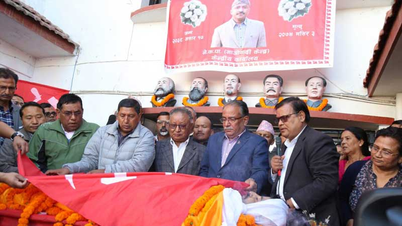 PArty Flag is being decorated over Prakash Dahal's dead body.