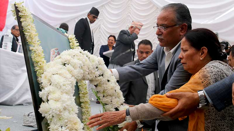 Chairman Prachanda and comrade Sita Dahal paying homage to Prakash Dahal