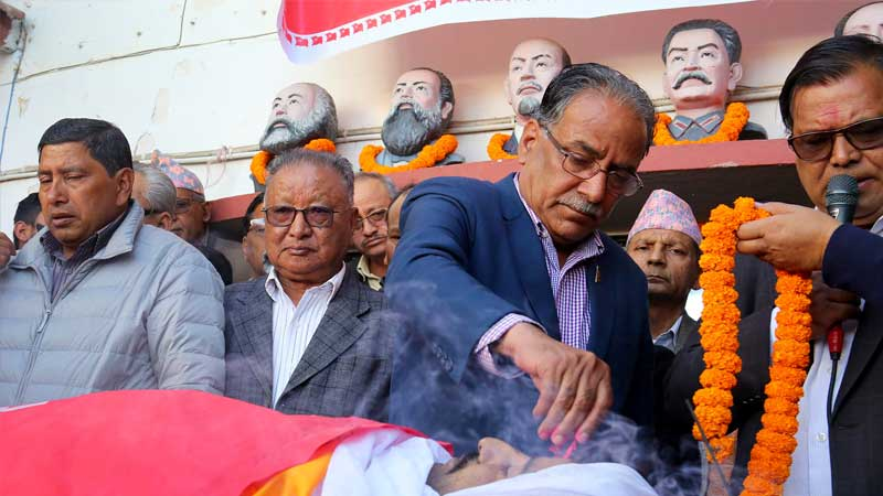 Comrade Prachanda paying homage to Prakash Dahal