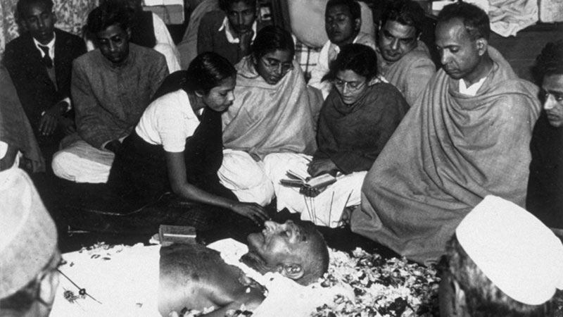 Mahatma Gandhi at the death bed after being shot by Nathuram Godse